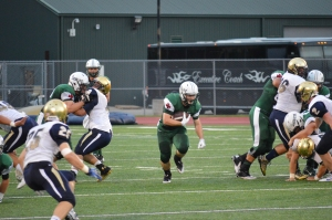 Dwyer Bucey '15 hits an open gap for a first down. Photo: MAGIS