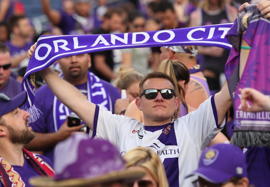 Fans cheer before the start of action as Orlando City plays host to the Vancouver Whitecaps at the Orlando Citrus Bowl in Orlando on Saturday, March 21, 2015. (Stephen M. Dowell/Orlando Sentinel/TNS)
